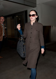 Christina Ricci kept her incognito style luxe with a monogrammed bag with leather trim.