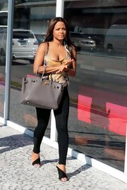 Christina Milian showed off her fit physique in a tight studded graphic tank.