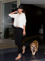 For a chicer finish, Chrissy Teigen teamed her sporty outfit with embellished gray ankle-cuff sandals.