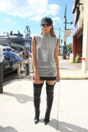 Ciara completed her attention-grabbing ensemble with a pair of embellished thigh-high boots.