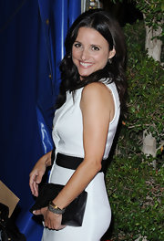 Julia Louis-Dreyfus paired a black leather clutch with her white sheath for a simple yet classy finish at the Cirque Du Soleil 'Kooza' opening.