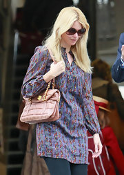 Claudia Schiffer showed off a pink quilted handbag while hitting the streets of London.
