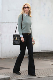 Claudia Schiffer donned round brown sunglasses. The oversize eye wear was both classic and on trend.
