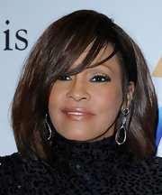 Whitney Houston wore glossy nude lipstick at the 2011 pre-Grammy party.
