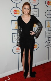 Brandi Cyrus looked divine in a black evening dress with embellished sleeves and double slits during Clive Davis' pre-Grammy gala.