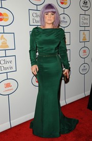 Kelly Osbourne cut a curvy silhouette in an emerald green gown during Clive Davis' pre-Grammy gala.