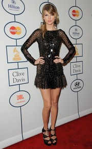 Taylor Swift went for a flirty look in a super-short beaded LBD by Zuhair Murad during Clive Davis' pre-Grammy gala.