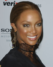 Tyra Banks accessorized her lacy look with these dangling earrings.