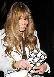 """Elle is wearing a nice white coat that she matched perfectly with this black and white """"Tatiana"""" clutch. It makes a statement with the gold chain detail."""
