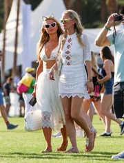 Nicky Hilton was spotted on day 1 of Coachella looking super cute in a white cutout mini dress by Jen's Pirate Booty.