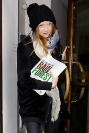 Lily Cole stayed cozy in fun style with a black pompon beanie during a visit to Vivienne Westwood's office.