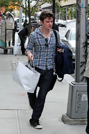 Chris opted for a casual blue plaid shirt.