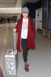 Constance Wu kept the rest of her look casual with a pair of black leggings and an Altuzarra logo shirt.