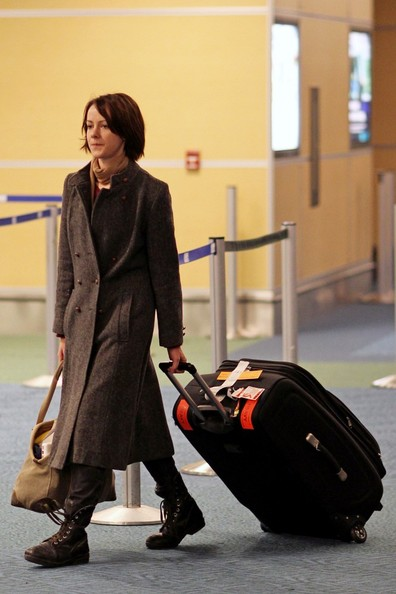 Jena Malone bundled up in a gray wool coat for a flight.