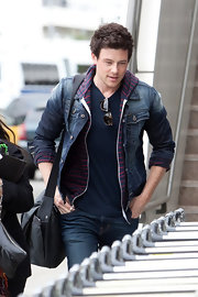 Cory Monteith layered up in this faded jean jacket and a striped hoodie.