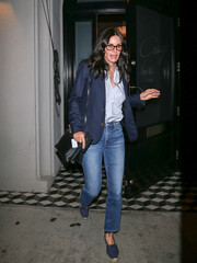Courteney Cox looked smart in a navy blazer layered over a pastel-blue shirt while enjoying a night out at Craig's.