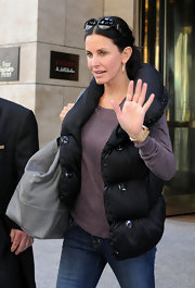 Courteney Cox kept warm while visiting NYC in a black down vest.