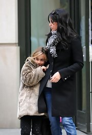 Coco Arquette looks toasty in her luxe fur coat while snuggling into mom Courteney Cox on the streets of NYC.