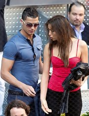 Cristiano Ronaldo showed off his athletic bod at the Madrid Masters in a fitted blue pin-striped polo.