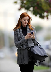 Marcia Cross gave her look a classic finish with a sleek black leather bowler.