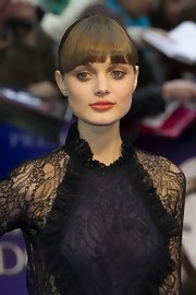 Bella Heathcote arrived at the UK premiere of 'Dark Shadows' wearing a pair of 18-carat rose gold snake stud earrings.