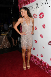 Karina Smirnoff flaunted her svelte figure in a partially sheer sequin dress during the launch of her cosmetic line.