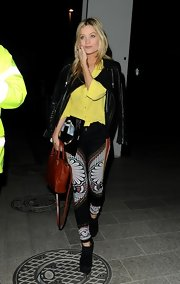 Laura Whitmore's canary yellow button down added another pop of color to Laura Whitmore's look while out in London.