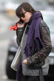 Daisy Lowe bundled up in this purple tasseled scarf while out in Primrose Hill.