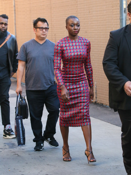 Danai Gurira polished off her look with black cross-strap sandals.