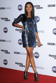 Brandy shined in a metallic blue and silver print mini dress.