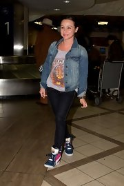 Danielle Harris looked cool and comfy in a denim jacket paired over a band tee and jeans.