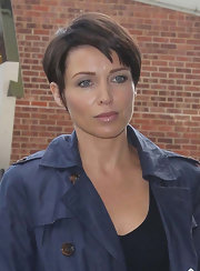 Dannii Minogue wore her short choppy crop with sexy side-swept bangs while in Battersea.