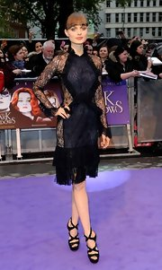 Bella Heathcote teamed her lace dress with a pair of Swarovski-encrusted sandals at the London premiere of 'Dark Shadows.'
