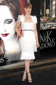 Bella Heathcote opted for gladiator heels by Jason Wu to match her white dress at a Los Angeles movie premiere.
