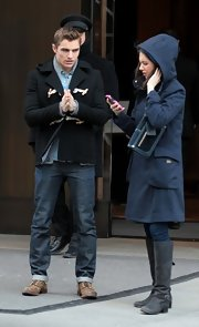 Alison Brie cozied up in a hooded teal coat while out and about in New York City.