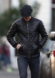 David Beckham's leather bomber jacket was super stylish for a walk through London.