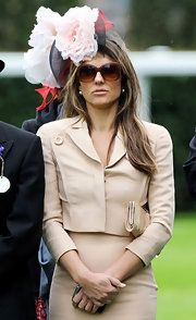 Elizabeth Hurley wore a dramatic floral fascinator for Royal Ascot Day 3.