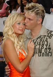 Paris shimmers in a soft blue eyeshadow while posing with Nick Carter.