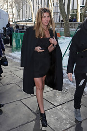Nina Garcia's LBD and textured black ankle boots were a super-chic and sexy pairing.