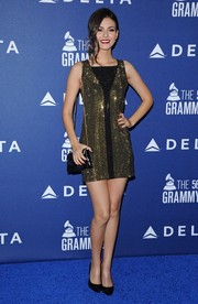 Victoria Justice sparkled in a beaded gold and black Versace dress at the Delta Air Lines Grammy party.