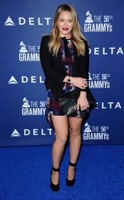 Hilary Duff layered a black Helmut Lang blazer over a printed mini dress for her Delta Air Lines Grammy party look.
