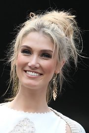 Delta Goodrem's glistening foliage-inspired earrings exuded bohemian elegance.