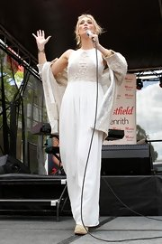 Delta Goodrem looked divine in a white maxi dress with an embroidered bodice as she performed in Sydney.