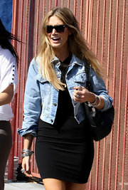 Delta Goodrem's washed-out denim jacket was a rugged finish to her LBD.