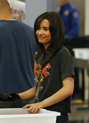 Demi wore an AC/DC concert tee while traveling through LAX.