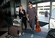 A leather duffle is clearly the way to go for Dev Patel. He's practical and fashionable!