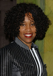 Regina King wore her hair in thick tight curls when she attended the Diamond Trading Company and InStyle luncheon.
