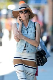 Diane Kruger wore a denim vest with her striped knit number.