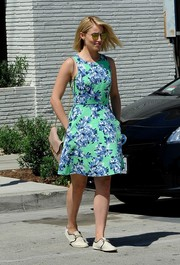 Dianna Agron was spotted in Beverly Hills looking pretty in a green and blue floral dress by J. Crew.