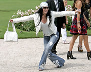 Cher completed her edgy outfit with a white leather tote when she attended the Dior fashion show.